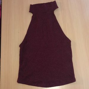Slightly cropped maroon halter top